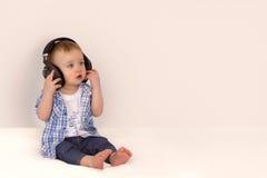 Little boy listening to music on headphones royalty free stock photos