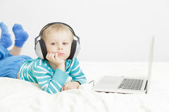 Little boy listening to music in headphones Stock Photography