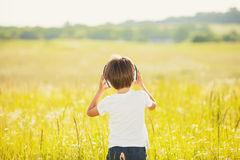 Little boy listening to music outdoors Royalty Free Stock Photography
