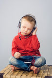 Little boy listening to music with smartphone. Stock Photo