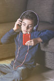 Little boy listening to music Royalty Free Stock Images