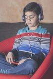 Little boy listening to music Royalty Free Stock Photos