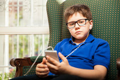 Little boy listening to music Stock Photography