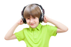 The little boy listens stereo music. Isolated on white background royalty free stock photos