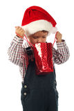 Little boy with little Christmas gift bag Stock Photo