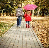 Little boy and little girl in the autumn park Stock Photo
