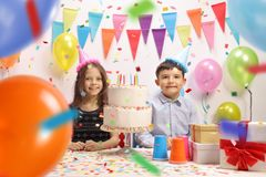 Little boy and a little girl celebrating a birthday Stock Photos