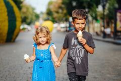 Little boy and little girl with ice cream. On the street Royalty Free Stock Photo