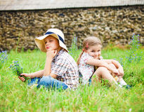 Little boy and little girl near the country house Stock Image
