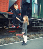Little boy and little girl near the train Royalty Free Stock Images