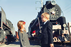 Little boy and little girl near the trains Stock Photography