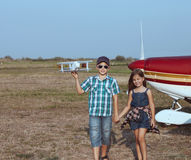 Little boy and little girl pilot with handmade plane Royalty Free Stock Photo