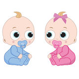 Little boy and little girl. Two little babies sitting on the floor. Boy and girl Royalty Free Stock Photos