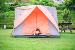 Little boy living inside the tent the park Royalty Free Stock Image