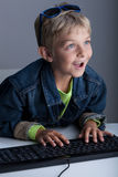 Little boy living in virtual world Royalty Free Stock Photography