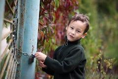 Little boy at lock door Royalty Free Stock Photo