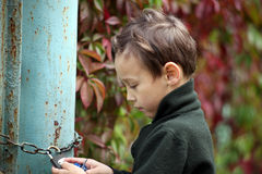 Little boy at lock door Stock Photography