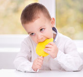 Little boy with lollipop Stock Photos