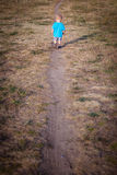 Little boy on a lonely walk Stock Photography
