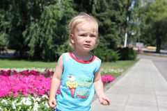 A little boy with long blonde hair Royalty Free Stock Photos
