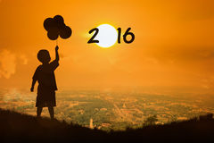 Little boy look at  sunset new year 2016 Stock Photography