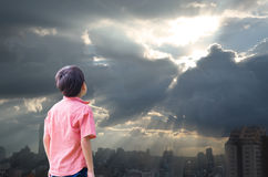 Little boy look up high in the sky sun with cloudy Royalty Free Stock Photography