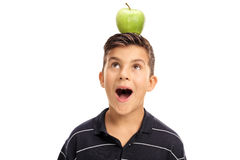 Little boy looking at an apple on his head. Overjoyed little boy looking at an apple on his head isolated on white background Stock Photos