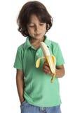 Little boy looking at a banana Stock Photos