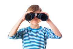 Little boy is looking through binocular Royalty Free Stock Photos