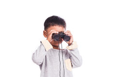 Little boy looking through binocular Stock Image