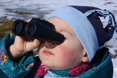 Little boy looking through binoculars Stock Photo