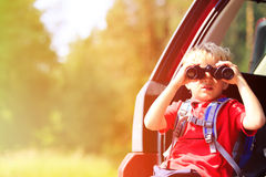 Little boy looking through binoculars travel by Stock Photo