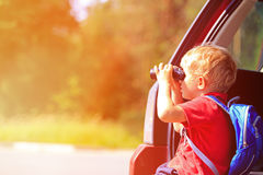Little boy looking through binoculars travel by Royalty Free Stock Images