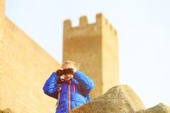 Little boy looking through binoculars while travel Stock Photo