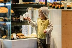 Little boy is looking at the buns. royalty free stock images