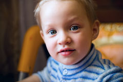 Little boy looking at the camera, blue eyes bright Stock Photography
