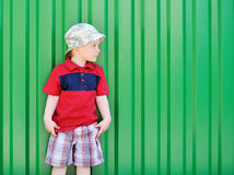 Little boy looking at copyspace. Adorable little boy looking at copyspace on green background royalty free stock images