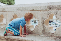 Little boy looking at Dubrovnik from old city walls. Little boy looking at the city of Dubrovnik from old city walls, discovering Croatia royalty free stock images