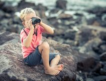 Little boy looking far away with binoculars Royalty Free Stock Images