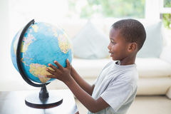 Little boy looking at the globe Stock Photo