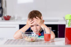 Little boy looking at his food in horror Stock Image