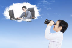 Little boy looking at his future job Stock Images