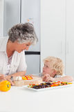 Little boy looking at his grandmother Royalty Free Stock Images