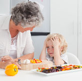 Little boy looking at his grandmother Stock Photos
