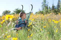 Little boy looking for his mom. Little boy sitting in a stroller concerned looking for his mom Royalty Free Stock Photo