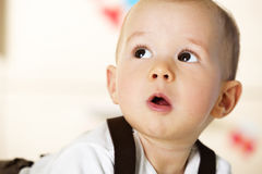 Little boy looking innocently. Stock Images