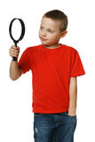 Little boy looking through the magnifying glass Stock Photography