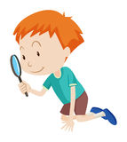 Little boy looking through magnifying glass Royalty Free Stock Photography