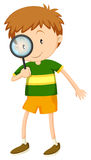 Little boy looking through magnifying glass Royalty Free Stock Images