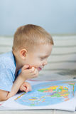 Little boy looking at map Royalty Free Stock Photography